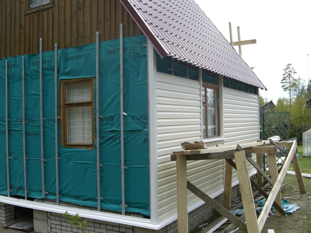 Сайдинг своими руками с утеплением деревянного дома